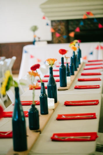 Painted bottles, wooden boards, and bunting at the reception