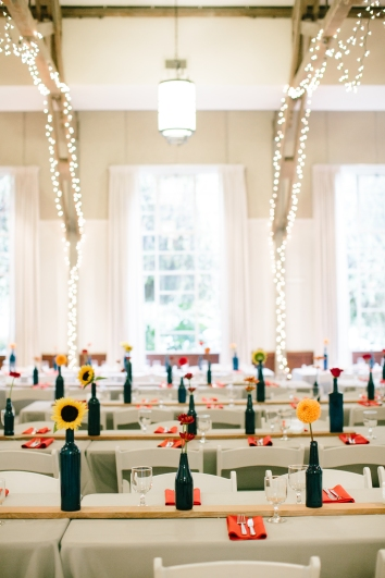 Painted bottles, wooden boards, and twinkly lights at the reception