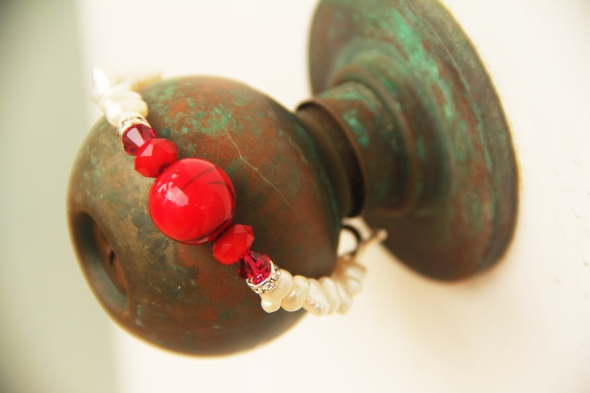 pearl bracelet on doorknob
